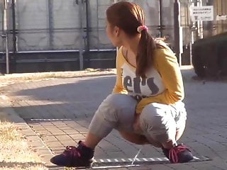 Japanese Girl Caught Pissing On Street
