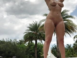 Thicc oiled beauty posing near pool