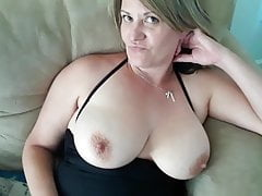 Milf playing with her tits